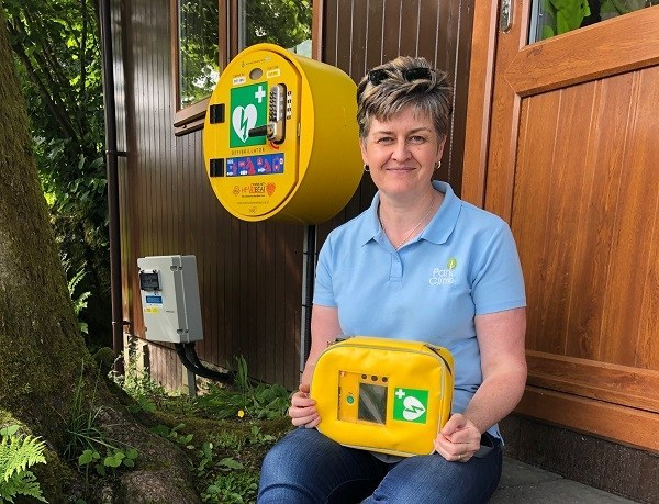 Susan Dickson with new installed defibrillator at Park Cliffe.