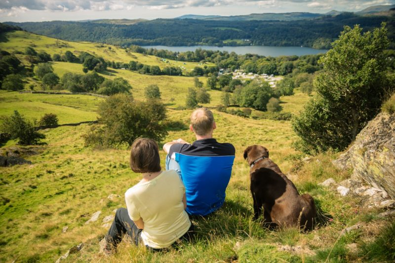 Lake Windermere couple with dog landscape Lake District