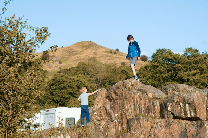 children boys on rocks park cliffe lake district